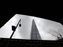 The Shard, Europe's tallest building is seen through an archway next to London Bridge station in central London