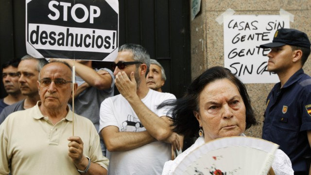 Demonstrators block the entrance to Milagros Carbajo's home as they try prevent her eviction in Madrid