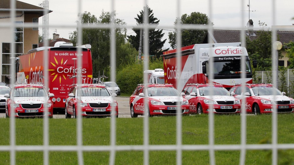 Cofidis buses are parked in front of the hotel of Cofidis cycling team in Bourg-en-Bresse