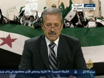 Still image of Syria's ambassador to Iraq Fares announcing his resignation