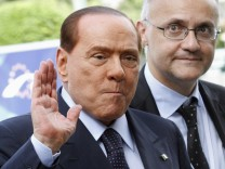 File photo of Italy's former PM Berlusconi arriving for an EPP meeting in Brussels