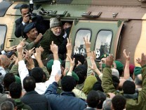 File picture of Palestinian President Arafat entering helicopter as he leaves his compound in Ramallah