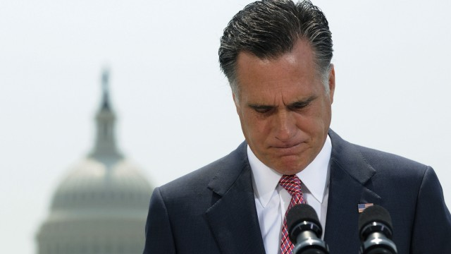 Romney pauses during his reaction to the Supreme Court's upholding of Obamacare in Washington