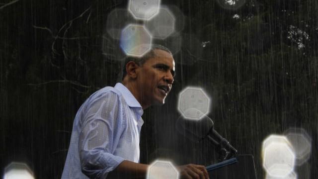 U.S. President Barack Obama speaks in the reain during a campaign event in Glen Allen