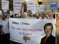 Protesters chant slogans against the visit of U.S. Secretary of State Hillary Clinton to Cairo