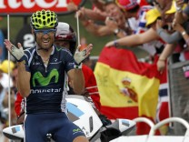 Valverde of Spain celebrates winning the 17th stage of the 99th Tour de France cycling race between Bagneres-de-Luchon and Peyragudes
