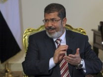 Egypt's President Mursi attends a meeting in Cairo