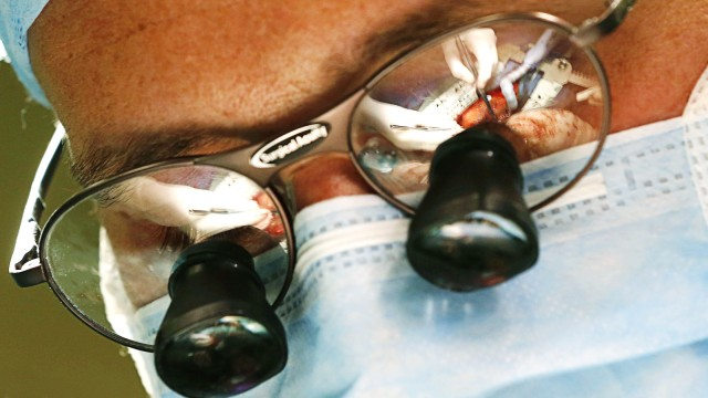 A heart surgery operation led by Professor Pirk is reflected in the glasses of doctor Urban at the IKEM in Prague
