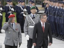 German Defence Minister de Maiziere and Chief of Staff of the German Military General Wieker inspect the guard of honour in Berlin