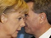 Merkel, Oettinger, ddp