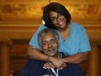 An HIV/AIDS patient poses with a nurse at the Broadway House for Continuing care in Newark