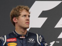 Red Bull Formula One driver Vettel of Germany reacts on the podium following the German F1 Grand Prix at the Hockenheimring