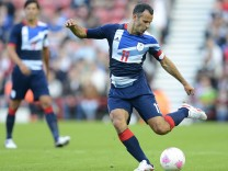 Giggs of Team GB kicks the ball during their Olympic men's friendly soccer match against Brazil ahead of the London 2012 Olympic Games at the Riverside Stadium in Middlesbrough