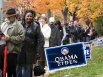 Voters queue outside a polling station on election day in Washington