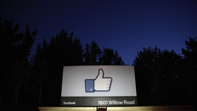 File photo of the sun rising behind the entrance sign to Facebook headquarters in Menlo Park