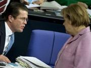 Merkel, Guttenberg, ddp