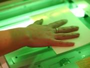 Hand auf Scanner