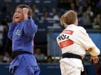 Brazil's Sarah Menezes celebrates after defeating Romania's Alina Dumitru in women's -48kg final judo match at London 2012 Olympic Games