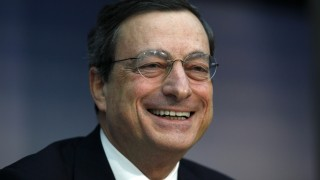 File photo shows ECB President Draghi smiling during the monthly news conference in Frankfurt