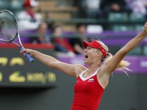 Russia's Sharapova celebrates after defeating Germany's Lisicki in their women's singles tennis match at the All England Lawn Tennis Club during the London 2012 Olympic Games