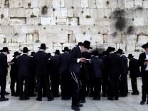 Ultra Orthodox Jews pray at the Western Wall