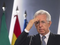 Italy's PM Monti gestures during a news conference at the Moncloa Palace in Madrid