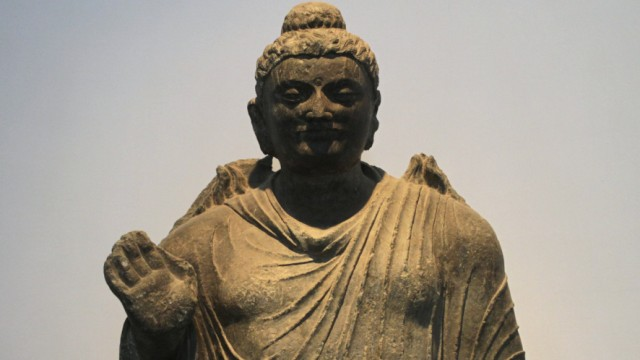 A stone Buddha statue is displayed at the Kabul National Museum in Kabul
