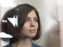 Tolokonnikova, member of female punk band 'Pussy Riot', sits in the defendant's cell before a court hearing in Moscow