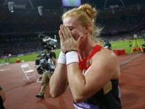 Germany's Betty Heidler reacts after winning the bronze medal in the women's hammer throw final at the London 2012 Olympic Games at the Olympic Stadium
