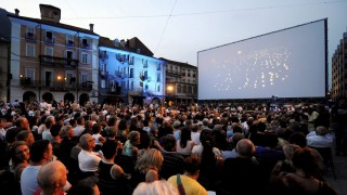 Spectators attend the screening of the movie 'Lore' by director Cate Shortland at the 65th Locarno Film Festival in Locarno