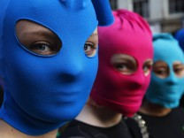 Protesters take part in Amnesty International flash mob demonstration in support of Russian punk band Pussy Riot in Edinburgh