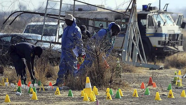 Forensic Unit Police investigates the scene where striking miners