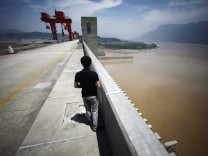 Man stands on the Three Gorges dam in Yichang
