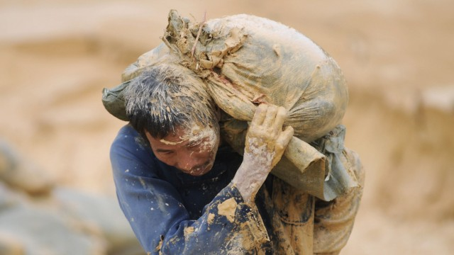 A labourer works at the site of a rare earth metals mine at Nancheng county, Jiangxi province