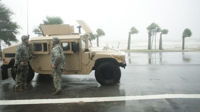 The Mississippi Army National Guard  keeps people off the streets during curfew along Beach Blvd. as Hurricane Isaac passes through Gulfport