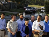 U.S. President Barack Obama talks to the media after he tours Hurricane Isaac damage and recovery efforts in the Ridgewood neighborhood of LaPlace in Saint John the Baptist Parish in Louisiana