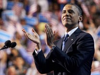 U.S. President Obama applauds before addressing final session of Democratic National Convention in Charlotte