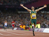 Oscar Pistorius of South Africa celebrates winning the Men's 400m T44 Final during the London 2012 Paralympic Games
