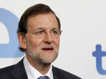Spanish PM Rajoy poses after arriving for an interview on national Spanish Public Television (TVE) in Madrid
