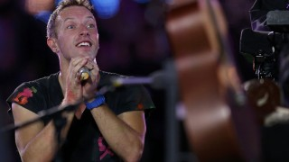 Chris Martin performs with his band Coldplay in the Olympic Stadium during the closing ceremony of the London 2012 Paralympic Games