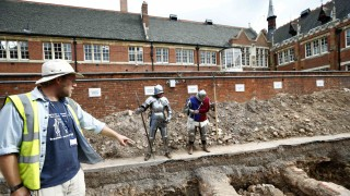 Archaeologist Mathew Morris points to where he found skeleton remains during an archaelogical dig to find the remains of King Richard III in Leicester