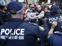 Protesters clash with police on a street in Sydney's central business district