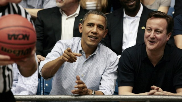 U.S. President Obama and British Prime Minister Cameron talk at NCAA basketball tournament game in Ohio