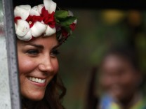 Britain's Catherine, the Duchess of Cambridge, smiles to locals as she departs the cultural village in Honiara