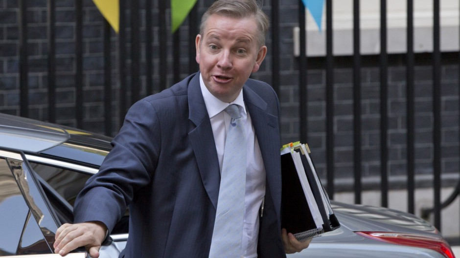 Britian's Education Secretary Michael Gove arrives at 10 Downing Street in London