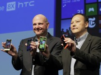 Microsoft CEO Ballmer and HTC CEO Chou display new Microsoft Windows 8 operating system phones at a launch event in New York