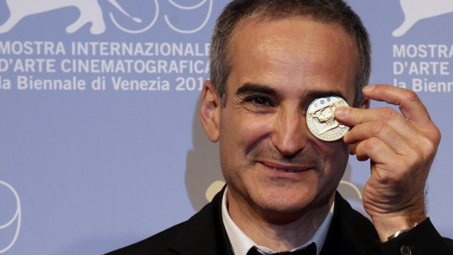 Director Olivier Assayas plays with the prize for the Best Screenplay for the film 'Apres Mai' at the 69th Venice Film Festival in Venice