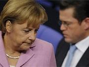 Guttenberg, Merkel, ddp