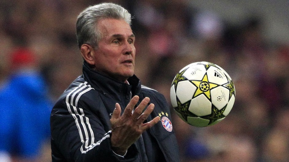 Bayern Munich's coach Jupp Heynckes catches a ball during their Champions League Group F soccer match against Valencia in Munich