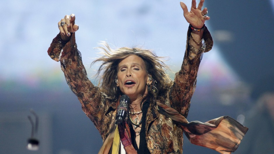 Steven Tyler of Aerosmith throws his sunglasses into the audience during second day of the 2012 iHeartRadio Music Festival at the MGM Grand Garden Arena in Las Vegas